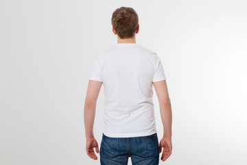 Young man wearing blank t-shirt isolated on white background. Copy space. Place for advertisement. Back view. Mock up. Template summer shirt