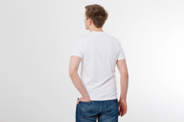 Young man wearing blank t-shirt isolated on white background. Copy space. Place for advertisement. Back view