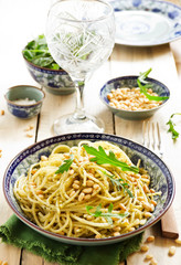 Spaghetti with pesto of arugula with pine nuts