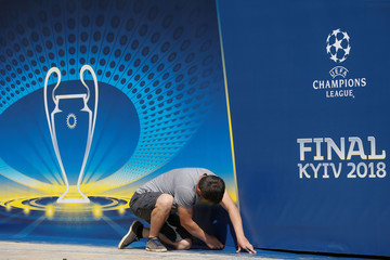 A man attaches a banner with the logo of the UEFA Champions League final in central Kiev