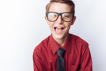 Portrait of a positive teenager on a white background, glasses, red shirt, advertising, text insert