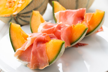 Slices of cantaloupe melon with ham