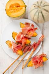 Melon with prosciutto and grissini