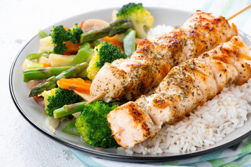 Chicken skewers with steamed vegetables and long rice