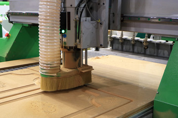 Manufacturing of a furniture facade on a modern woodworking machine. Milling machine.