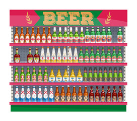 Supermarket shelf display with beer bottles.