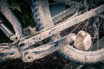 Mountain biking, dirty and broken bicycle closeup