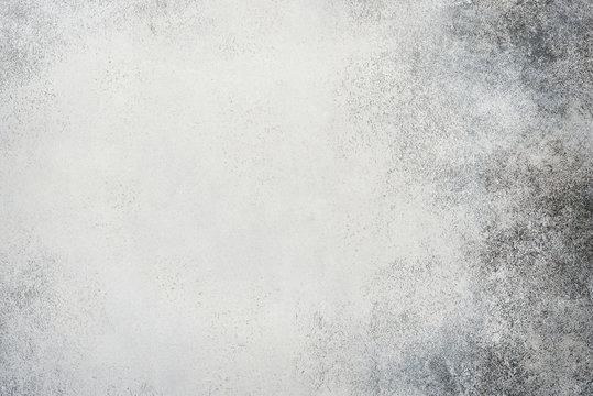 Light grey stone or slate wall.