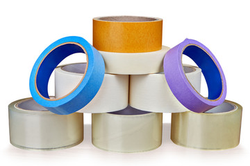 Set of adhesive tape is stacked in form of pyramid.