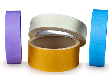 Several multi-colored rolls of adhesive tape on an white background.