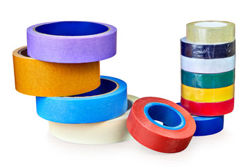 Two stacks of rolls of multi-colored adhesive tape,  on white.