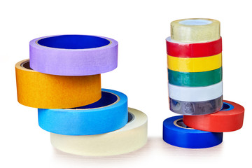 Two stacks colorful rolls of duct tape,  on white.