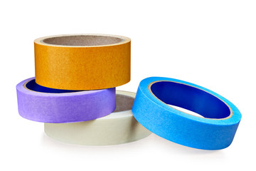 Colored rolls of  paper and plastic  duct tape on white.