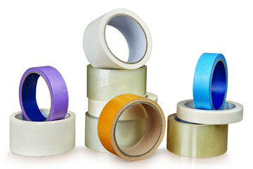 Several rolls of adhesive tape for different purposes on white.