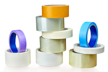 Various rolls of adhesive tape on white.