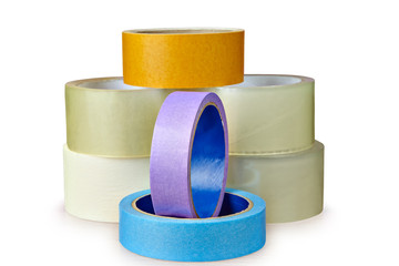 Pile of adhesive tape lies on table,  white background.