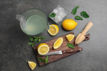 Flat lay composition with delicious natural lemonade on gray background