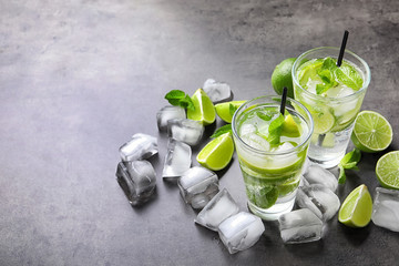 Refreshing beverage with mint and lime on table