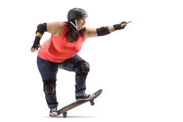Overweight woman wearing protective gear doing a manual with a skateboard