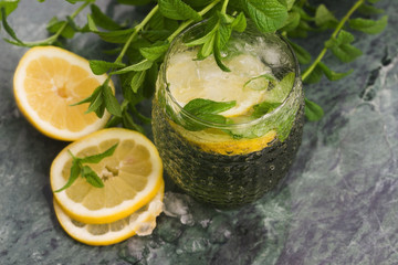 Tasty cold fresh drink lemonade with lemon, mint and ice