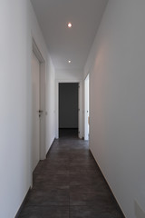 Corridor with white walls and doors
