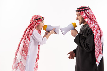 Arab father and little son in national attire