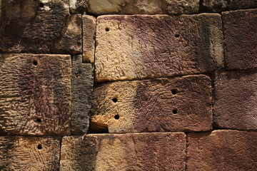 Ancient Stone block wall in Angkor Thom, Siem Reap, Cambodia. UNESCO World Heritage Site.