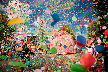 Acrylic Prints Carnaval confetti falling during a festival or carnival in the city