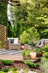 Terrace with garden armchair