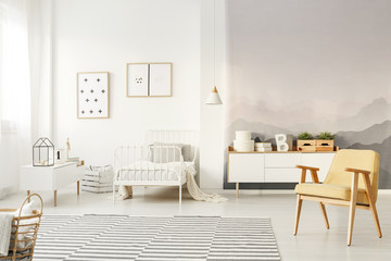 Yellow armchair in kid's bedroom