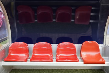 Papiers peints Stade de football Detail of red Reserve chair and staff coach bench in sport stadium