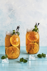 Iced tea with lemon slices and mint.