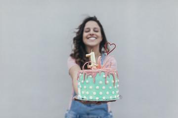 Woman presenting Birthday cake
