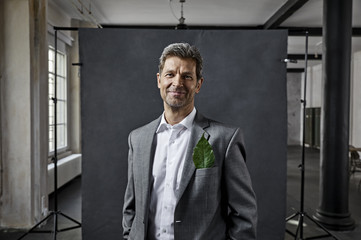 Portrait of businessman with leaf in pocket