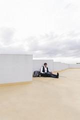 Businessman sitting at parking garage