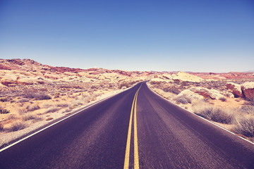 Vintage toned picture of a desert road, travel concept.