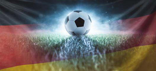 Fußball auf Stadionrasen mit Deutschlandfahne