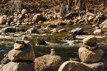 stacked rocks on rivers edge