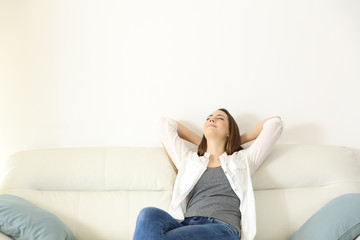 Woman relaxing on a couch with copy space above