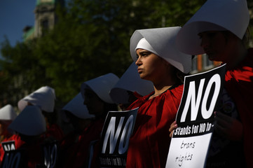 Pro-Choice demonstrators dress up as characters from the Handmaid's Tale ahead of a May 25 referendum on abortion law, in Dublin