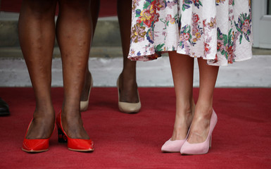 Spain's Queen Letizia's and Haiti's first lady Martine Moise's shoes are seen as they pose for a picture during Queen's visit to the National Palace in Port-au-Prince