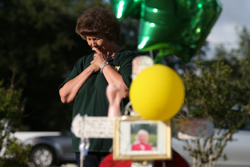 A woman mourns at a makeshift memorial left in memory of the victims killed in a shooting at Santa Fe High School in Santa Fe