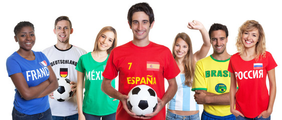 Spanish soccer fan with ball and cheering group of other fans
