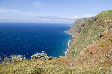 View from Ponta do Pargo view point, view over the cliff, amazing wild nature greenery, blue deep Atlantic ocean, Madeira island