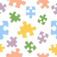 Colorful seamless pattern with doodle puzzle pieces.