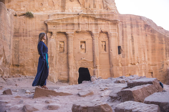 Girl in old city Petra in the desert of Wadi Musa in Jordan, a UNESCO world heritage valley
