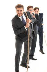 closeup.smiling business team pulls the rope.