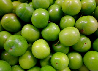 Green plums fresh, fruits background