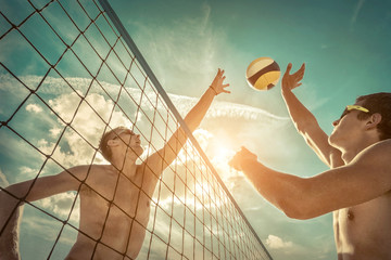 Beach Volleyball players in sunglasses under sunlight.