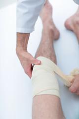 closeup. doctor bandaging a patient's leg